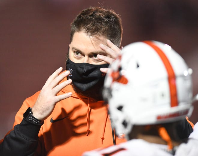 Massillon coach Nate Moore makes a point during the Division II state championship game last November.