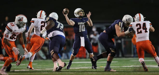Archbishop Hoban quarterback Shane Hamm finished his high school career by leading the Knights to their third state title in the past four years and was named to the Beacon Journal All-Star offensive football team. [Jeff Lange/Beacon Journal]