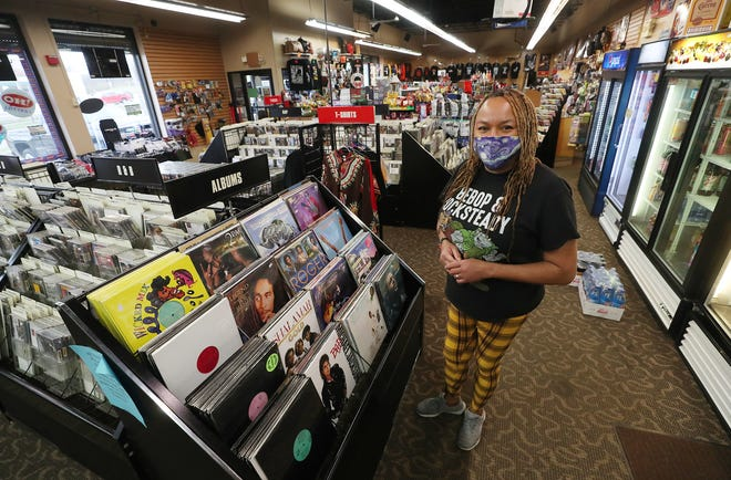 Norma Heard, co-owner of 2 Live Music, talks about business during the pandemic at her Akron store on Vernon Odom Boulevard.