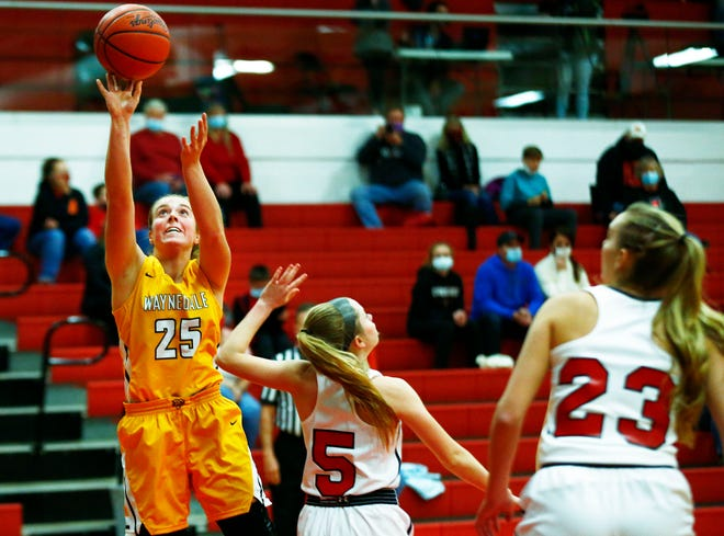 Waynedale's Brooklyn Troyer (25) goes up for a shot as Crestview's Frankie Dinsmore (5) tries to block during high school girls basketball action Friday at Crestview High School. The Golden Bears won, 48-39.