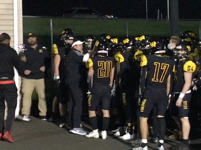 Archbishop Wood coach Matt Walp addresses his team before the second half of Friday's game. The Vikings beat Conwell-Egan 41-7.