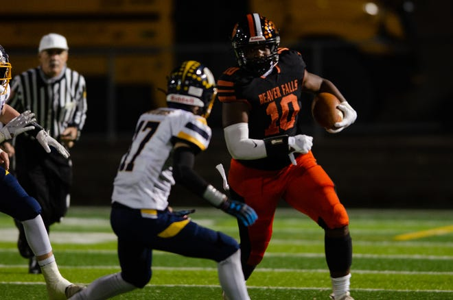 Beaver Falls running back Josh Hough (10) looks for yards against Wilmington during the PIAA Class 2A semifinal Friday night at Geneva College's Reeves Field.