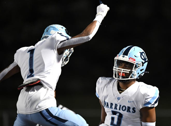 Central Valley quarterback Ameer Dudley celebrates his three-yard touchdown run against Bedford with Myles Walker (1) during a PIAA 3A semifinal Friday at Mansion Park in Altoona.