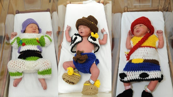 """In honor of the 25th anniversary of """"Toy Story"""" on Sunday, nurses at Allegheny Health Network's West Penn Hospital in Pittsburgh dressed up three newborns as some of the beloved characters from the Disney classic. From left in this photo composite, are Ellis as Buzz Light Year, Santana as Woody and Mia as Jessie. West Penn welcomes thousands of newborns into the world every year and often uses holidays and anniversaries, such as """"Toy Story,"""" to showcase the work taking place at the hospital and highlight the joy these babies bring to their families and AHN caregivers every day. For these little ones, West Penn Hospital says it hopes that their dreams will take them to """"infinity and beyond."""""""