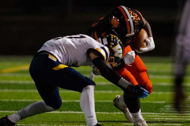Beaver Falls running back Josh Hough lowers the shoulder on a Wilmington defender during the PIAA Class 2A semifinal Friday night at Geneva College's Reeves Field.