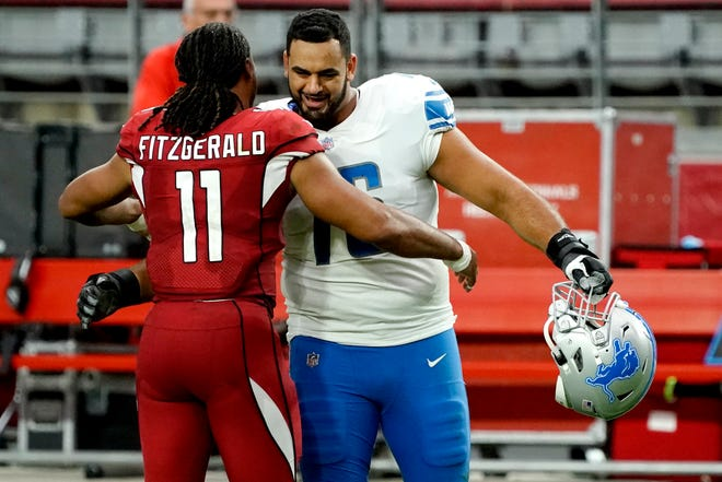 Cardinals wide receiver Larry Fitzgerald greets Detroit Lions offensive guard Oday Aboushi after a September game in Glendale, Arizona.