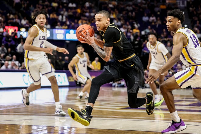 Missouri guard Xavier Pinson (1) drives to the basket against LSU during a Southeastern Conference game Feb. 11 at Maravich Assembly Center in Baton Rouge, La.