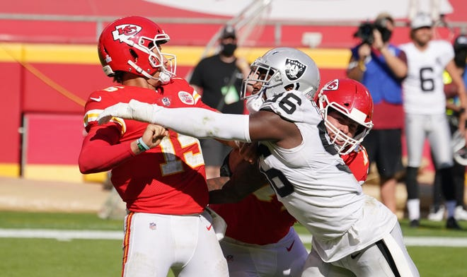 Kansas City Chiefs quarterback Patrick Mahomes (15) is hit by Las Vegas Raiders defensive end Clelin Ferrell (96) during a game Oct. 11 at Arrowhead Stadium in Kansas City.