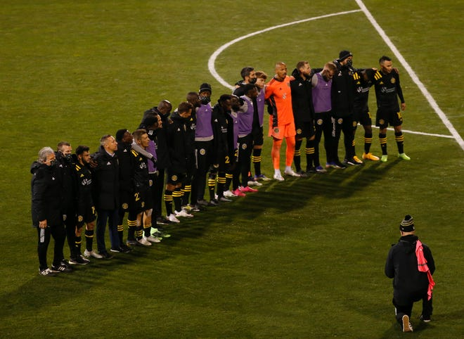 Crew players celebrate their 3-2 win over New York Red Bulls in a playoff match at Mapfre Stadium on Nov. 21.