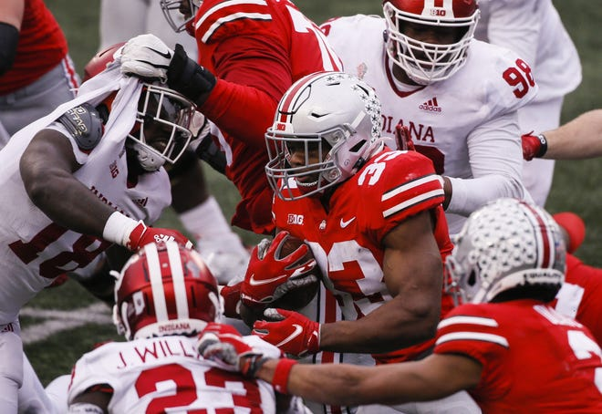 Ohio State Buckeyes running back Master Teague III (33) runs the ball during the fourth quarter of a NCAA Division I football game between the Ohio State Buckeyes and the Indiana Hoosiers on Saturday, Nov. 21, 2020 at Ohio Stadium in Columbus, Ohio.
