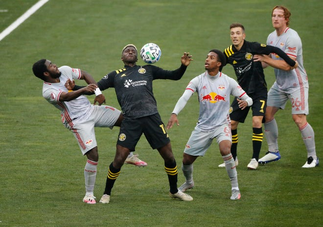 Crew forward Gyasi Zardes, center, fights for a header with Red Bulls midfielder Dru Yearwood, left, and defender Kyle Duncan during the first half at Mapfre Stadium.
