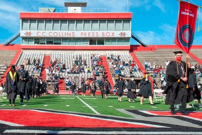 Nicholls State University graduates enter John L. Guidry stadium for the morning graduation ceremony Nov. 21.