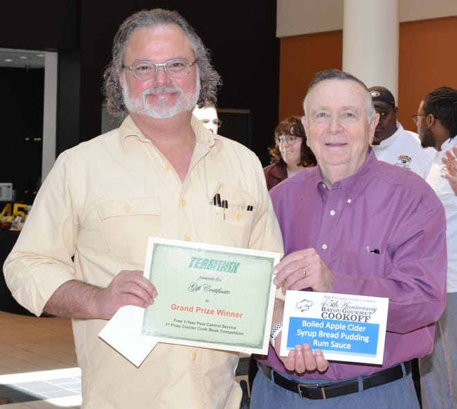 Patrick Adams (left), winner of the Grand Prize at the 45th Bayou Gourmet Cookoff, accepts a gift certificate from Dan Foster (right), co-owner of Terminix of Houma.