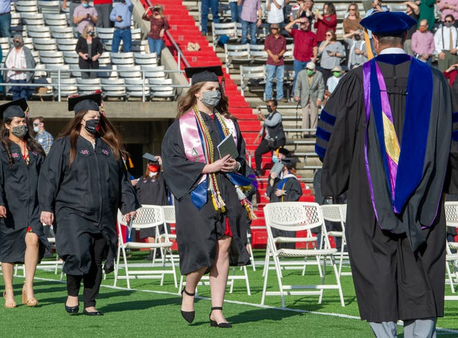 Nicholls State University graduates enter the John L. Guidry stadium for the morning fall commencement ceremony Saturday.
