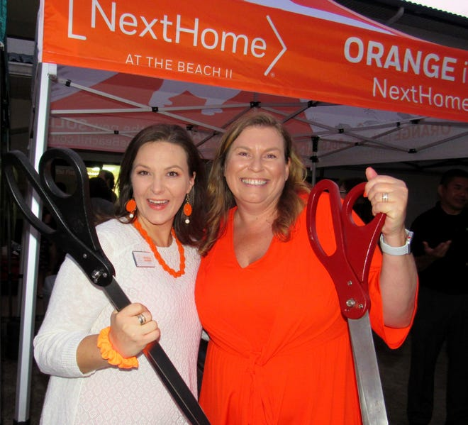 Owner/agent Michelle McKinney and Paige Brewer, broker/owner of NextHome At the Beach II, officially cut the ribbon on their new office on Old Kings Road in Palm Coast, after COVID postponed the event in the spring.