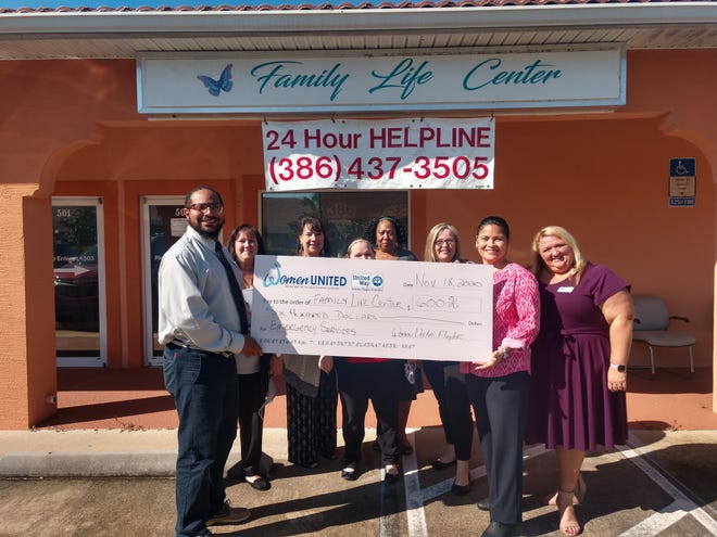 Staff at the Family Life Center display their grant check.