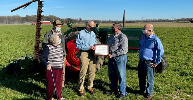 Sen. Tom Carper, D-Delaware, joined Delaware Farm Bureau President Richard Wilkins on Nov. 20 to accept the Friend of the Farm Bureau Award for the 116th Congress.  Carper accepted the award at Delaware Agriculture Museum President Grier Stayton's farm.