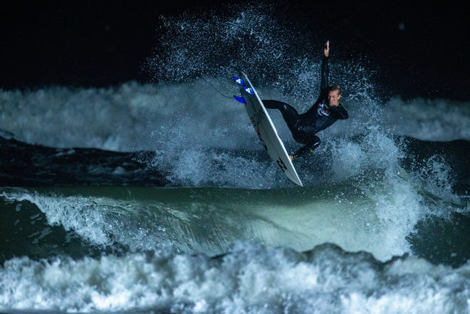 Cody Thompson performs at the Red Bull Night Riders surf contest where he won the $5,000 prize Friday night at Hanna Park.