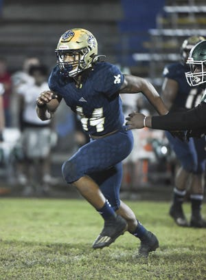 Sandalwood linebacker Branden Jennings (44) runs downfield during a Nov. 20 regional playoff game. Jennings, who signed with Maryland, headlines the annual Super 24 selection of top Northeast Florida football recruits.