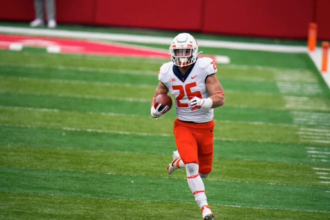 Illinois running back Mike Epstein (26) carries the ball during the first half of an NCAA college football game against Nebraska in Lincoln, Neb., Saturday, Nov. 21, 2020. (AP Photo/Nati Harnik)