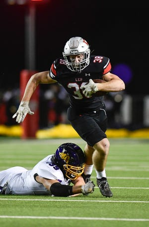Lubbock-Cooper's Cutter Douglas (38) runs the ball during a District 3-5A, Division II game against Abilene Wylie on Nov. 20 at Pirates Stadium at First United Park in Woodrow.