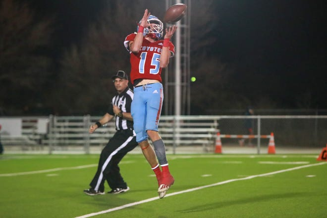 Borden County's Ky Edwards (15) catches a pass for a touchdown during a Class 1A Division I regional championship game Friday, Nov. 20, 2020, against Springlake-Earth at Tiger Stadium in Slaton, Texas.