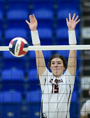 Lubbock-Cooper's Kaitlin Mayo (15) blocks the ball against Plainview during a Class 5A bidistrict match Nov. 21 at Lubbock Christian University's Rip Griffin Center. The Lady Pirates suffered a five-set loss to El Paso High in a 5A area round match Monday in Fort Stockton.