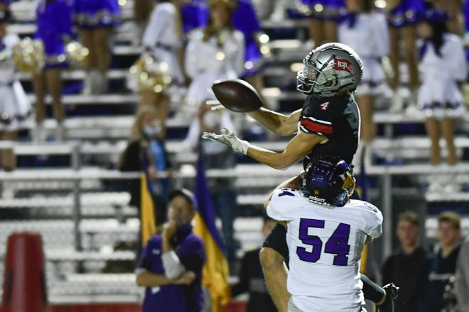 Lubbock-Cooper's Rylan Wilcox (4) catches the ball during a District 3-5A, Division II game Nov. 20 against Abilene Wylie at Pirates Stadium at First United Park in Woodrow, Texas.