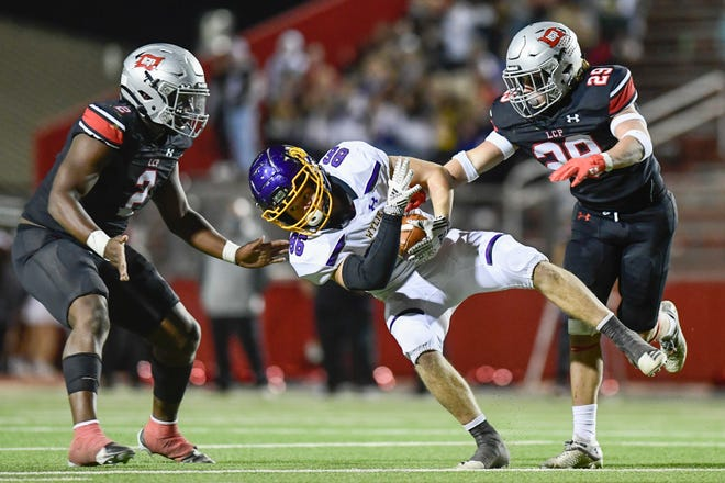 Lubbock-Cooper's Kyle Lewis (29) knocks down Wylie's Riley Hood (86) Friday, Nov. 20, 2020 at Pirate Stadium in Woodrow, Texas. [Justin Rex/For A-J Media]