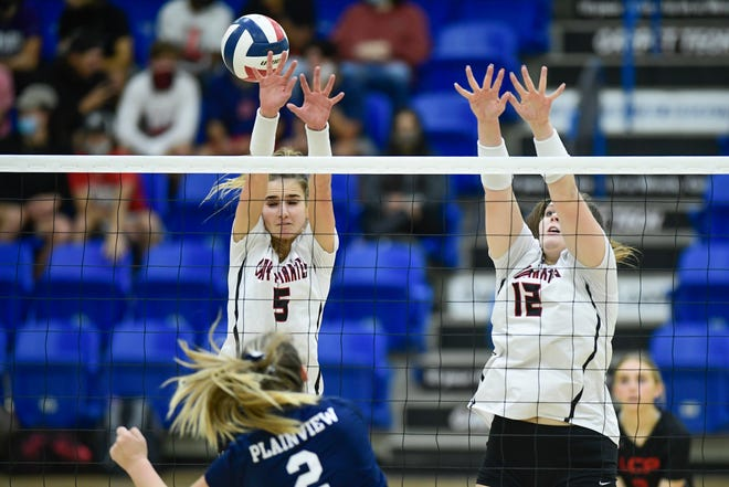 Lubbock-Cooper's Hollin Level (5) and Nicole Campbell (12) attempt to block the ball against Plainview in the Rip Griffin Center Saturday, Nov. 21, 2020, in Lubbock, Texas.