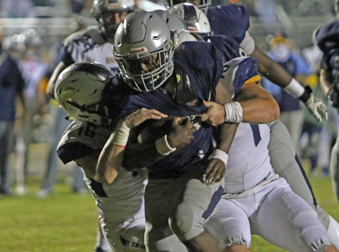 Ridge Community running back Beau Herrington is tackled at the 1-yard line in the first quarter against George Steinbrenner on Friday night.