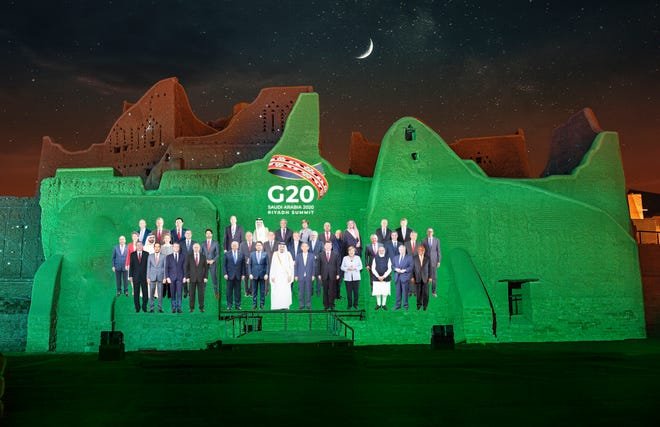 A family photo featuring members of the G20 is projected onto the walls of Salwa Palace at Turaif on Saturday in Diriyah, on the outskirts of Riyadh, Saudi Arabia. (Meshari-Alharbi, DGDA via AP)
