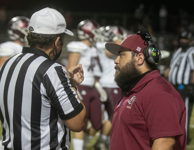 Lake Gibson High School head football coach Robert Paxia argues a call with the referee during the first quarter against Braden River High School in their Class 6A Region 3 quarterfinal playoff game at Lake Gibson High School Friday night.