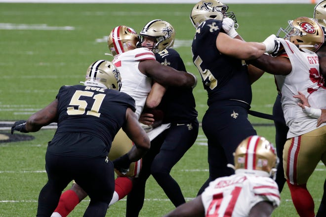 San Francisco 49ers defensive end Kentavius Street (95) sacks quarterback Drew Brees (9) during the first half Sunday in New Orleans. The Saints placed Brees on injured reserve Friday, meaning he'll miss at least three games with rib injuries. Brees was unable to finish Sunday's game after absorbing a heavy hit on a sack attempt by 287-pound San Francisco defensive tackle Street, who was penalized for roughing on the play.