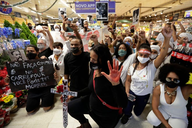 Activists, including members of Black Lives Matter, demonstrate Friday against the murder of Black man Joao Alberto Silveira Freitas at a different Carrefour supermarket the night before, on Brazil's National Black Consciousness Day in Brasilia, Brazil. Freitas died after being beaten by supermarket security guards in the southern Brazilian city of Porto Alegre, sparking outrage as videos of the incident circulated on social media.