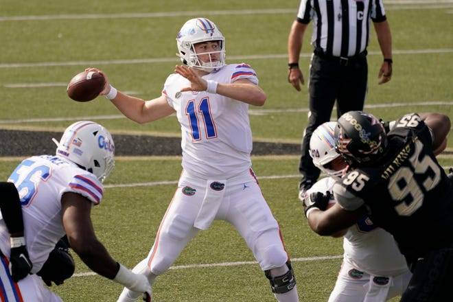 Florida quarterback Kyle Trask throws a pass against Vanderbilt in the first half on Saturday.