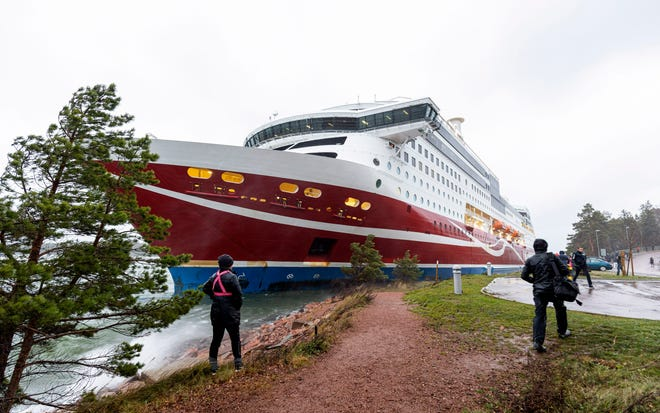 """A view of the Viking Line cruise ship Viking Grace, run aground with passengers on board, south of Mariehamn, Finland, on Saturday. A Baltic Sea ferry with 331 passengers and a crew of 98 has run aground in the Aland Islands archipelago between Finland and Sweden. Finnish authorities say there are """"no lives in immediate danger"""" and the vessel isn't leaking. The Finnish coast guard tweeted Saturday afternoon that the Viking Line ferry that runs between the Finnish port city of Turku and Swedish capital Stockholm hit ground just off the port of Mariehamn, the capital of the Aland Islands."""