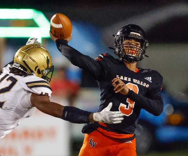 Lake Wales quarterback Tyron Summerall throws downfield past the closing Bishop Moore defender Tyler Dinga during the FHSAA playoff football game at Legion Field in Lake Wales on Friday.