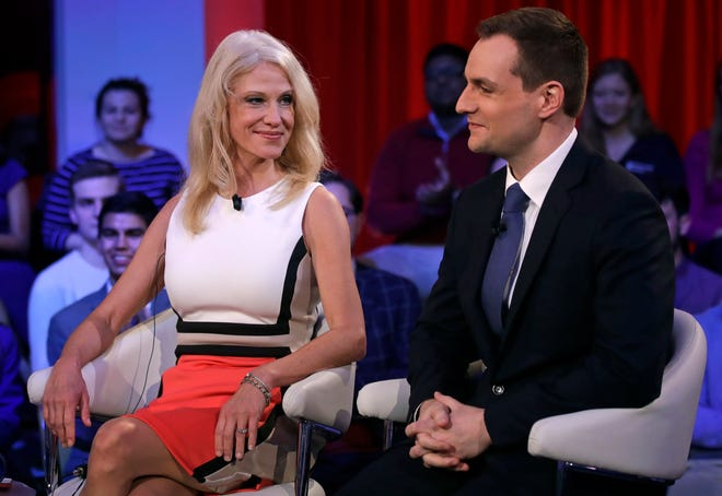 In this Dec. 1, 2016 file photo, Kellyanne Conway, the then campaign manager for Donald Trump, left, looks towards Robby Mook, the then campaign manager for Hillary Clinton, prior to a forum at Harvard University's Kennedy School of Government in Cambridge, Mass. A petition circulating at Harvard University demands that school officials create new accountability standards for former Trump administration officials who seek to work or speak on campus, an idea that has drawn outrage from prominent conservatives. [AP Photo/Charles Krupa, File]