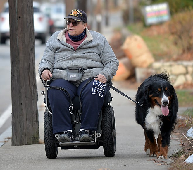 "Gary Duvall walks his dog ""Bear"" on Speen Street in Natick, Nov. 21, 2020. Recently, a work crew voluntarily cleaned his gutters, declining payment and thanking him for his service."