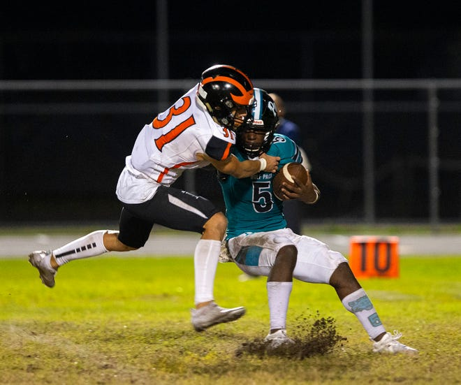 Spruce Creek's Ben Soard brings down West Port's JyLique Barnes. The Wolf Pack fell to Spruce Creek 35-12 in the Class 8A regional quarterfinals Friday night.