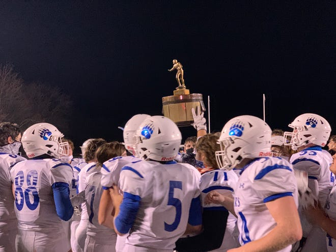 The Pleasant Valley High School football team celebrates winning the 60th annual Old Oaken Bucket Game on Friday, Nov. 20, 2020. The Bears won 42-0 over Pocono Mountain East.