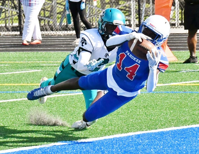 Pahokee receiver Mike Hale dives for a touchdown catch on fourth down before the first half expires. The reception put the Blue Devils up 22-0 at halftime.