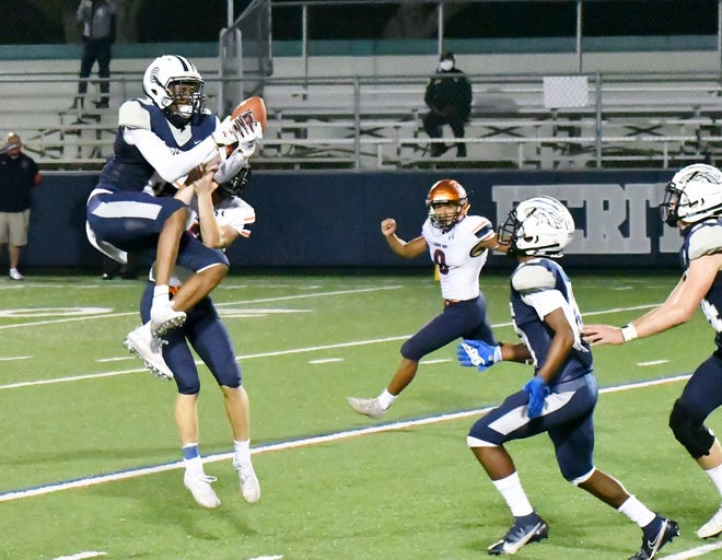 American Heritage defensive back KJ Stewart jumps a route for an interception. His turnover was part of a dynamic defensive performance in which the Stallions held Lemon Bay to seven points in Friday's regional semifinals game.