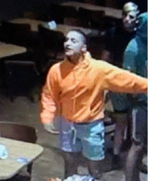 Sheriff's officials say they've identified two men they were seeking in regards to a Nov. 3 beating at a Royal Palm Beach IHOP restaurant.  This man in this image, wearing an orange top, is a man they believe was the aggressor in the incident. The other man has been identified as a witness to the crime, the office reported Sunday.