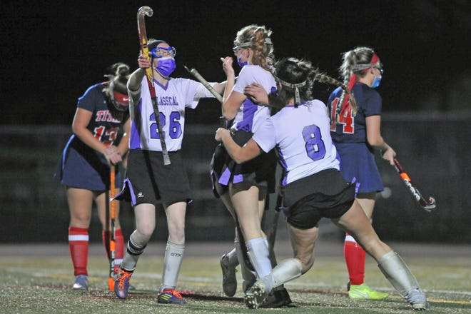 Classical's Ella Boyan, left, and Eli Howett, right, go to hug teammate Annabelle Doyle after her goal with 47.6 seconds left in the third quarter gave the Purple a 1-0 lead over Toll Gate in Saturday's D-III championship game. [The Providence Journal / Eric Rueb]