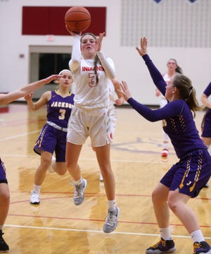 Ashley Cudnik (3) of Northwest puts up a floater while being guarded by Alayna McMullen (right) of Jackson  during their game at Northwest on Friday, Nov. 20, 2020.