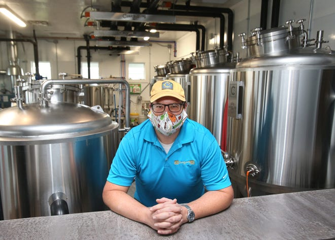 Jason Gasper-Hulvat stands in the production space at Codex Brewing, which recently opened in Jackson Township. After working for several area breweries, Gasper-Hulvat now is owner and brewer at his own business.