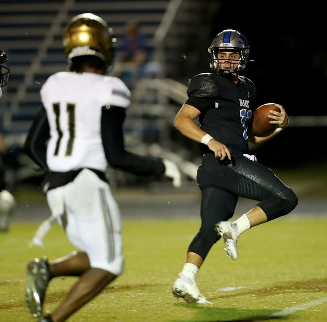 Bartram Trail quarterback Santino Marucci (11) scores a second quarter touchdown against Oakleaf Friday at Bartram Trail.