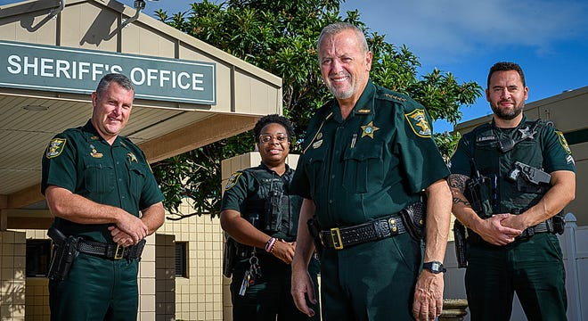 St. Johns County Sheriff David Shoar stands with Commander Bill Werle, Deputy Brittany Cicero and Corporal Samuel DeLuca in front of agency headquarters in St. Augustine on Friday. Shoar is retiring as sheriff after 16 years in January.
